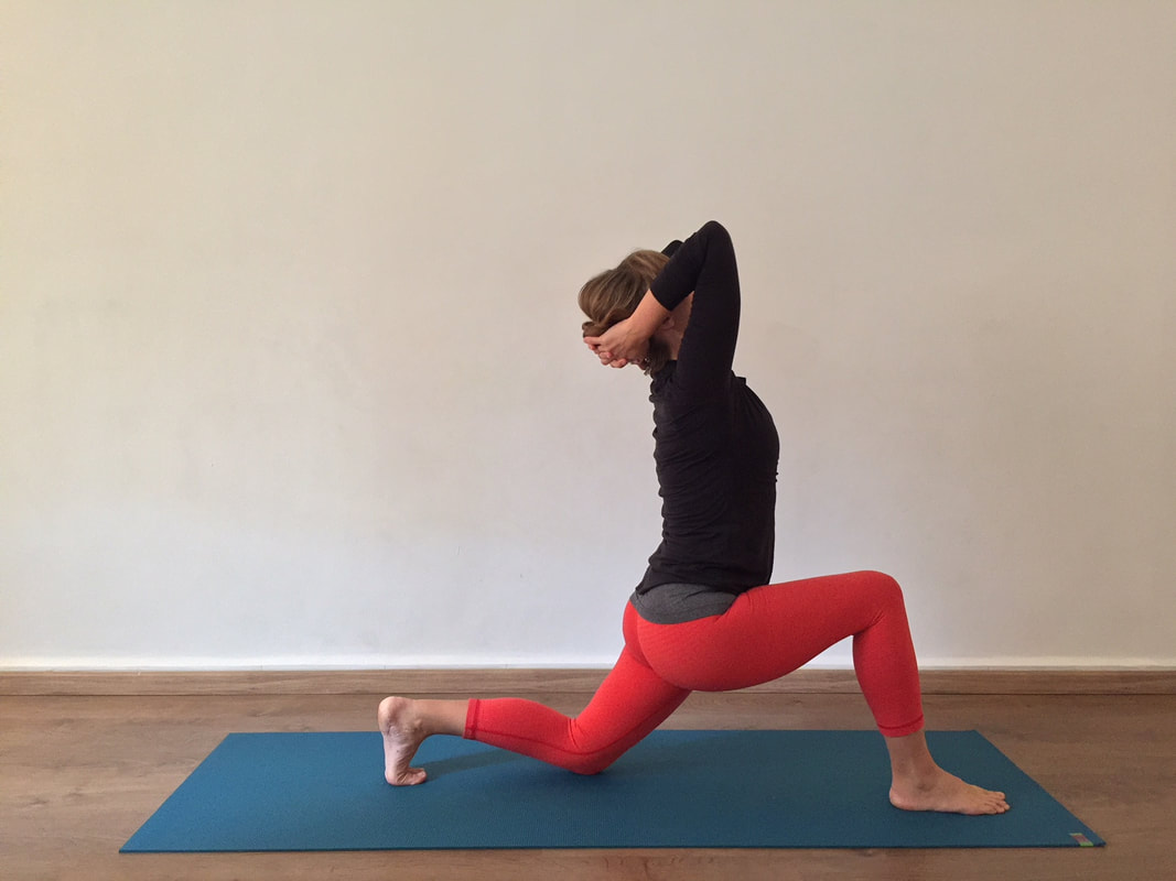Hands behind head in a lunge
